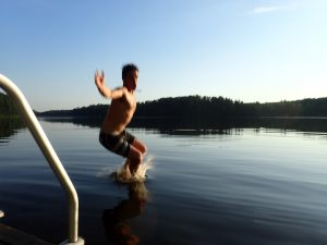 Swimming in a forest lake in Nuuksio