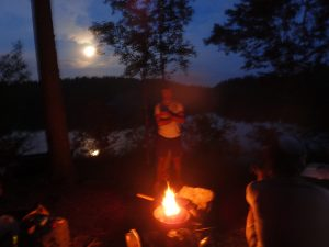 Coffee break on moonlight canoeing trip