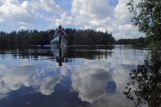Canoeing on Wilderness lakes of Nuuksio National Park