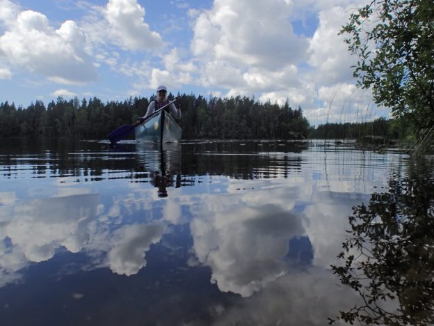 Canoeing on Wilderness lakes of Nuuksio National Park