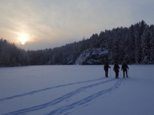 Winter hiking on frozen lakes in Nuuksio National Park