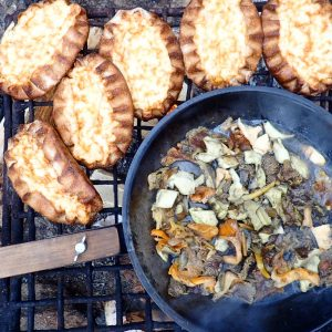 Fresh wild mushrooms and Karelian pastries by the fire