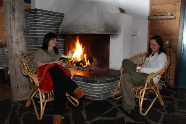 By fireplace at Jerishovi Lodge